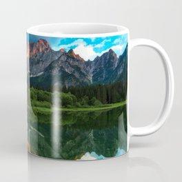 Burning sunset over the mountains at lake Fusine, Italy Coffee Mug