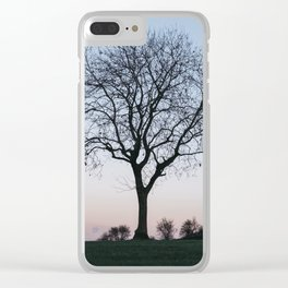 Tree on a hilltop above Matlock silhouetted at twilight. Derbyshire, UK. Clear iPhone Case