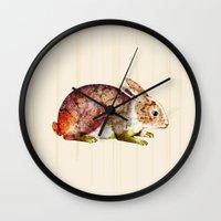 bunny Wall Clocks featuring Bunny by TatiAbaurreDesigns