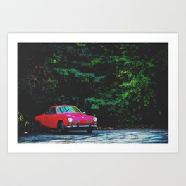 red classic car in the forest with green tree background Art Print