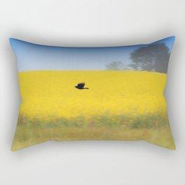Blackbird over the canola field Rectangular Pillow