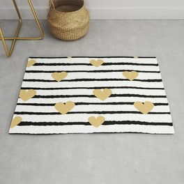cute pattern with hand drawn gold hearts on black and white stripes Rug