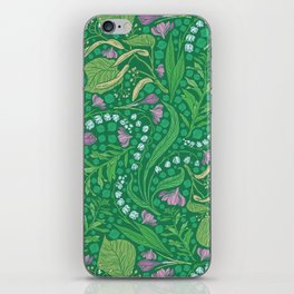Lilies of the valley and crocuses on green background iPhone Skin