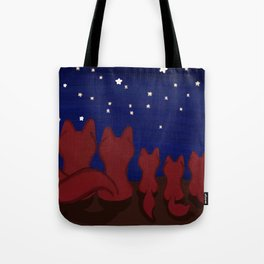 Red fox familly in a starry night Tote Bag