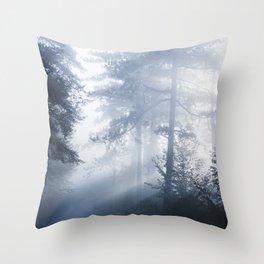 Sun rays shinning through foggy forest Throw Pillow