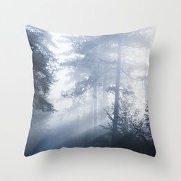 Sun rays shinning through foggy forest Throw Pillow