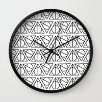 deathly hallows Wall Clocks featuring Deathly Hallows by bookotter