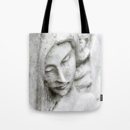 Angel face on stone memorial eyes closed Tote Bag