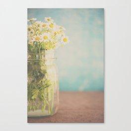 A mason jar full of pretty flowers. Canvas Print