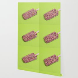 Ice cream on stick with colorful sprinkles over green background Wallpaper