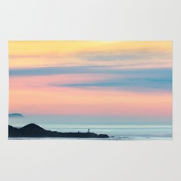 Sunset Overlooking the Yaquina Head Lighthouse Rug