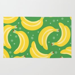 Vector bananas in a green background Rug