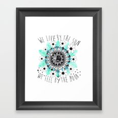 We live by the sun, We feel by the moon. Framed Art Print
