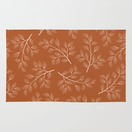 Delicate White Leaves and Branch on a Rust Orange Background Rug