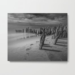Footprints and Pilings on the Beach in Black and White at Kirk Park by Grand Haven Michigan Metal Print