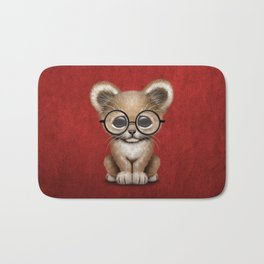 Cute Baby Lion Cub Wearing Glasses on Red Bath Mat