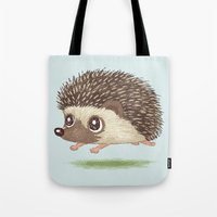 hedgehog Tote Bags featuring Hedgehog by Toru Sanogawa