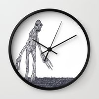 muscle Wall Clocks featuring Muscle Man by Nick Gibney