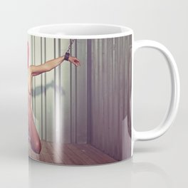 Nude woman cuffed with heavy iron cuffs in a steel container Coffee Mug