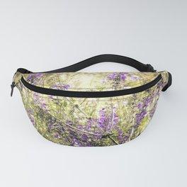 Wild purple flowers in meadow Fanny Pack