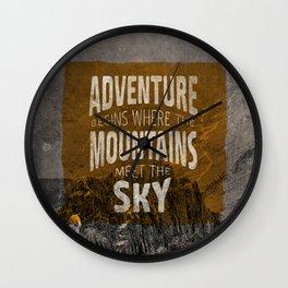 Adventure begins where the mountains meet the sky Wall Clock