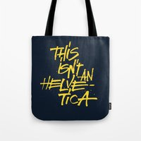 "lettering Tote Bags featuring ""Helvetica"" Lettering by Srg44"