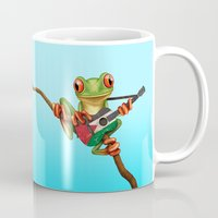 palestine Mugs featuring Tree Frog Playing Acoustic Guitar with Flag of Palestine by Jeff Bartels