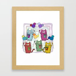 Funny colorful cats with gifts and inflatable balls in their paws Framed Art Print