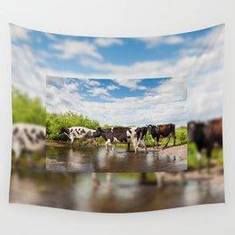 Herd of cows walking across pool Wall Tapestry