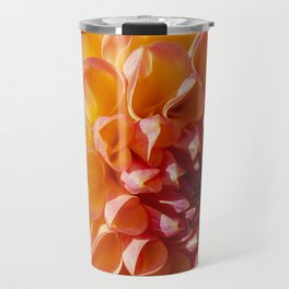 A Fiery colored Dahlia (Asteraceae) shines in the morning sun Travel Mug