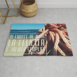 in front of the sea happiness is a simple idea Rug