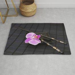 Zen pink Orchid flower on black Rug