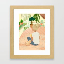 girl with cat relaxing at home looking out the window Framed Art Print