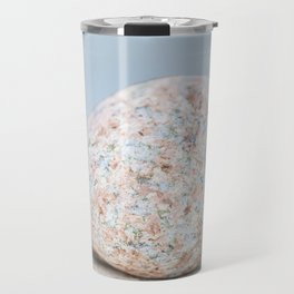 Granite pebble with blue water background Travel Mug