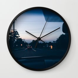 Driving into the sunset Wall Clock