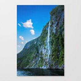 One of the numerous waterfalls falling down the sheer cliffs at Milford Sound. Canvas Print