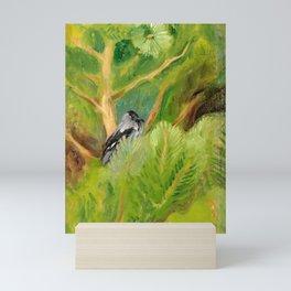 bird seating on green tree Mini Art Print