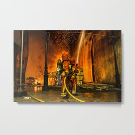 Firefighters putting out fire Metal Print