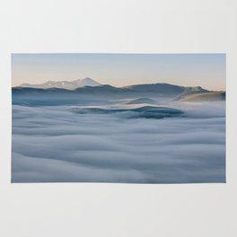 Above the fog, Castelluccio, Italy Rug