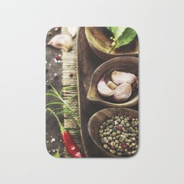 wooden bowls with fresh herbs and spices ( garlic, pepper, bay leaves, salt) Bath Mat