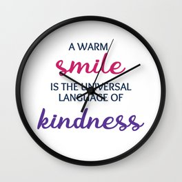 A warm smile is the universal language of kindness Wall Clock