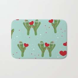 Cactus couple holding shining red hearts Bath Mat