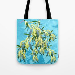 Beautiful Australian Wattle blooms against a textured blue background Tote Bag