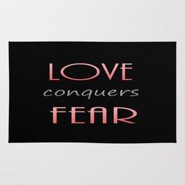 LOVE conquers FEAR Rug