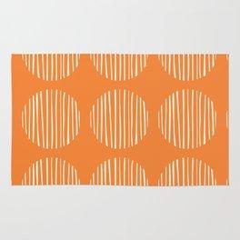 Circle stripes on orange Rug