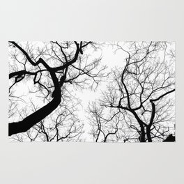 Black and white tree top silhouettes... Rug