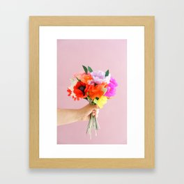 Hand holding paper flowers Framed Art Print