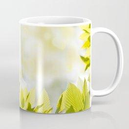 Elm green bright leaves and blurred bokeh Coffee Mug