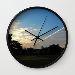 drama in the sky Wall Clock