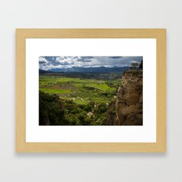 Cliffs in the city of Ronda, Spain. View of the field covered with clouds. Framed Art Print